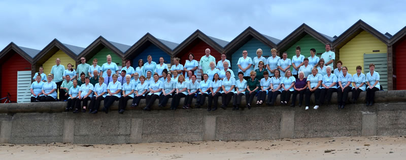 BVDF group photo next to beach huts